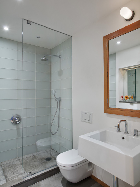 Minimalist Bathroom Using Glass Tile Walls And Glass Shower Also Hung Sink Plus Framed Mirrors For Inexpensive Bathroom Remodeling Ideas