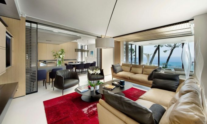 Modern Family Room With Brown Sofa And Standing Floor Lamp