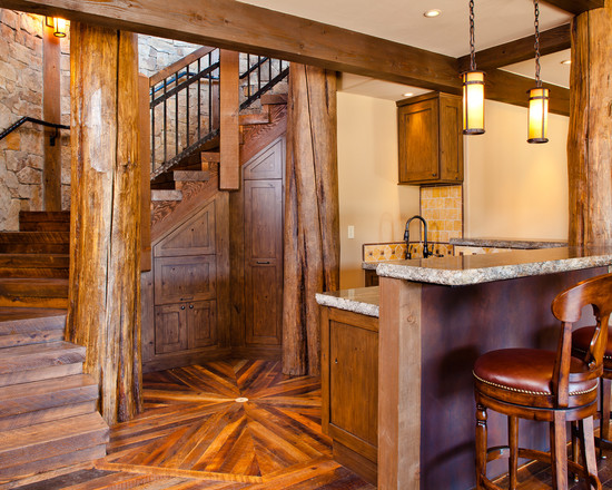 Rustic Basement With Pallet Wood Floor And Bar Counters And Log Wood Pillar