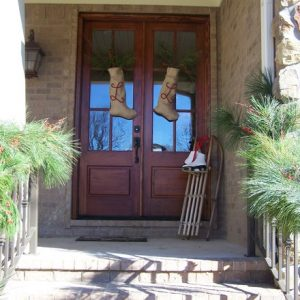 Rustic House Design With Double Wood Pocket Doors And Enty Streps With Cedar Garland For Christmas Contemporary Door Wreaths