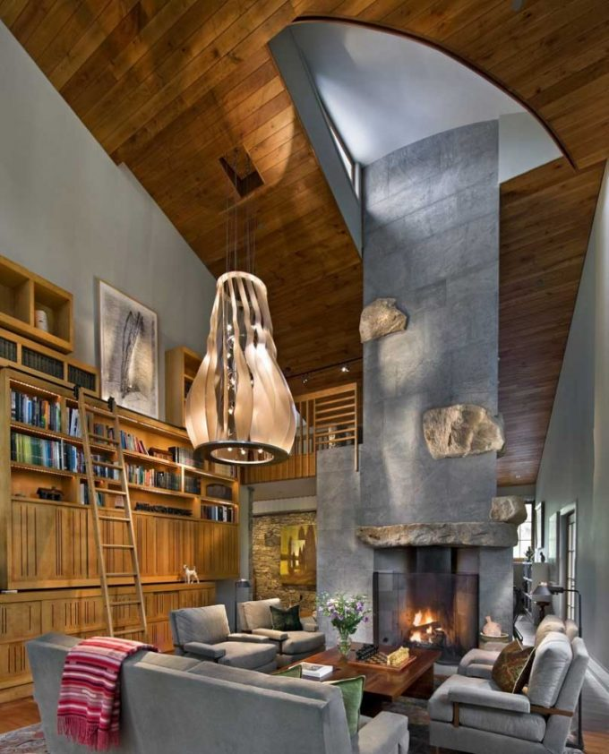 Stunning Waterftont House Interior With Wood Fireplace And Wooden Ceiling