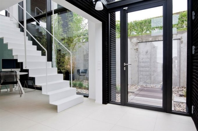 Stylish Staircase With White Color Stair And Simple Handrailing For Modern Villa Design