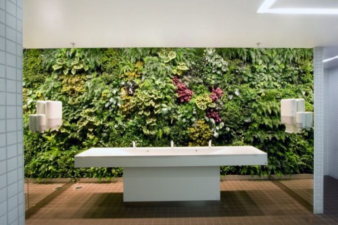 The Powder Room Design With Mirrors On Both Side Of Walls And Green Wall