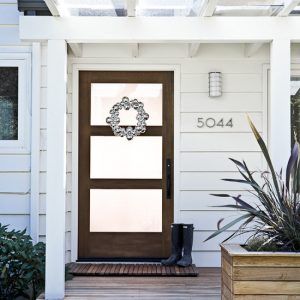 Traditional Entry With Glass Pocket Door With Contemporary Door Wreaths And Wood Siding Aslo Wood Porch