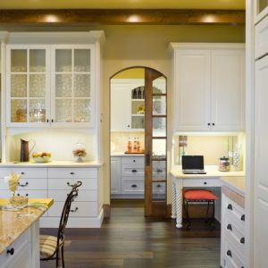 Traditional Kitchen With Glass Wooden Pocket Doors And White Cabinet With Glass Door