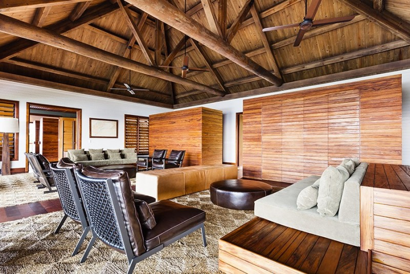 Traditional Tropical House Interior With Wooden Ceiling And Wooden Cabinets Also Rugs Area With Dark Chair And Sofa Bench