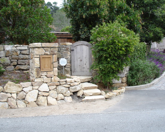 Vintage Exterior With Fence Mounted Mailbox And Stone Fence Also Green Trees And Street