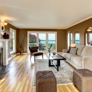 White Oak Hard Wood Flooring In Wonderful Living Room With Arched Doorways And Area Rug Also Ottoman Plus White Sofa