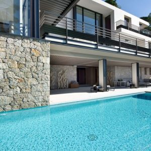 Wonderful Pool With Stone Wall Decor