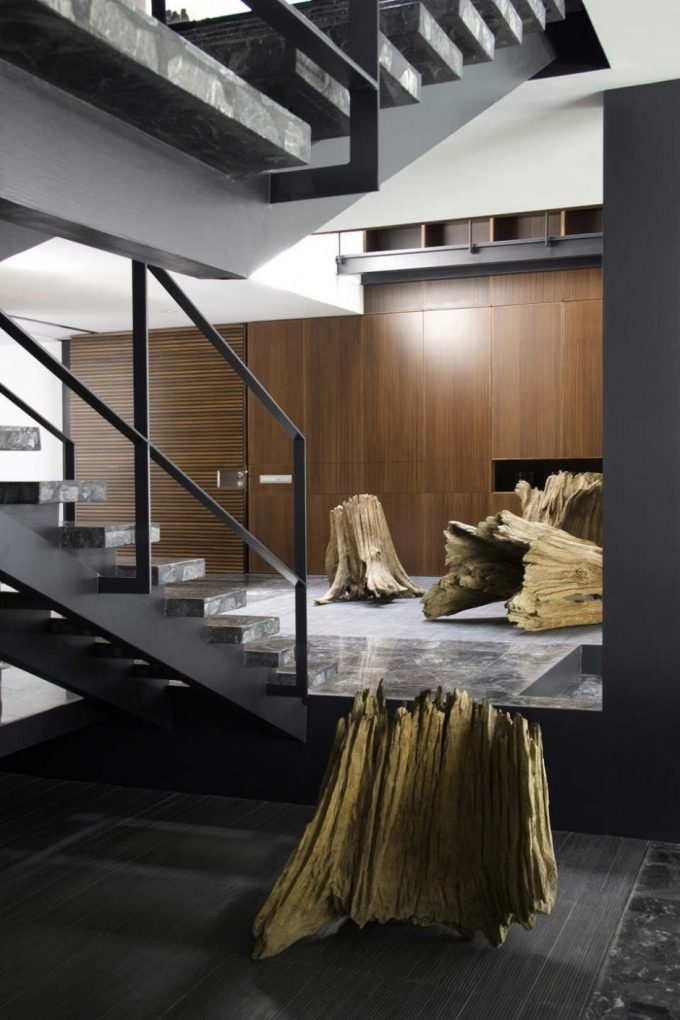 Artistic Wood Trunk For Interior Decor And Granite Floating Staircase With Steel Handrail And Grey Pillar