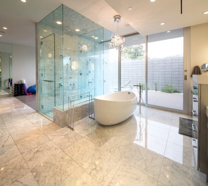 Awesome Bathroom With Glass Shower Room And White Boat Tub Also Marble Flooring Plus Floor To Ceiling Windows