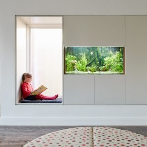 Awesome Reading Spot And Fish Tank Decor Also Soft Grey Cover For Seating