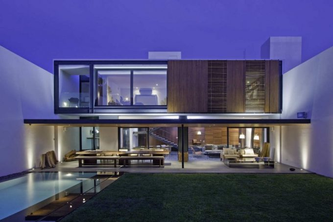 Beautiful Two Story Home Design With Lovely Terrace And Open Landscape With High Concrete Fence
