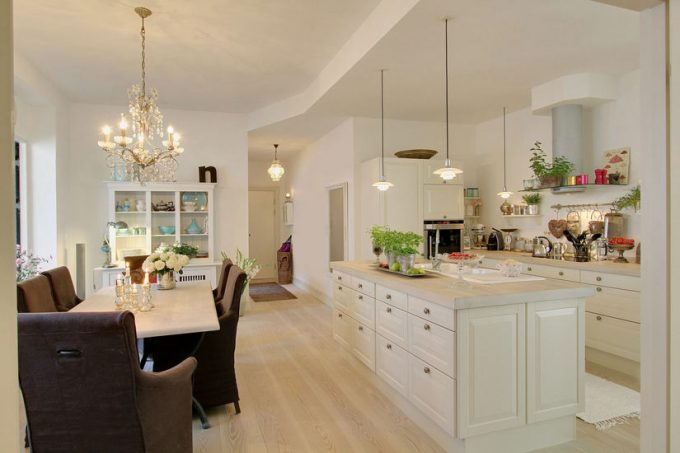 Breezy And Airy Kitchen Design With Kitchen Island With Storage Using Bright Wooden Floor Also White Wall And Ceiling