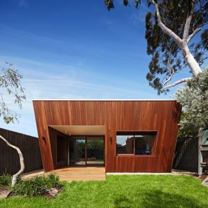 Contemporary House Extention With Wooden Exterior And Green Outdoor Space In Minimalist Style House Design
