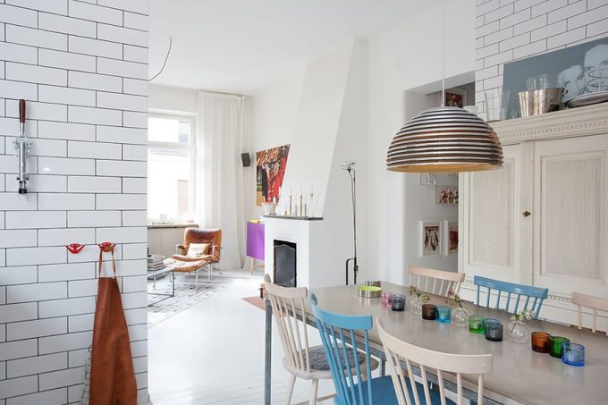 Lovely Dining Room With Colorful Glassware On The Dining Table White Brick Wall Design Also Unique Pendants And Cabinets