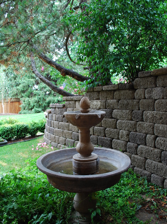 Lovely Landscape Design With Traditional Landscape Style Using Designer Bird Baths And Stone Fence