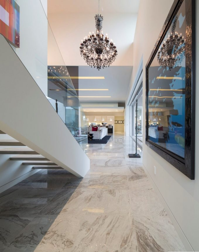Luxury House Design With Elegant And Gorgeous Interior Using Great White Marble And Chandelier Also Glass Windows