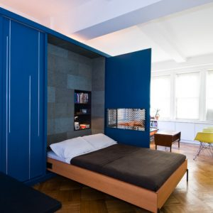 Modern Bedroom Using Blue Cabinets With Wall Bed Couch And Wood Flooring And Brown Bedding For Compact Room Design