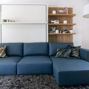 Modern Living Room With Blue Sectional Sofa Alaos Wall Bed Couch With Glossy Color