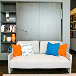 Wall Bed Couch Design With Shelving And White Coouch For Limited Room Space
