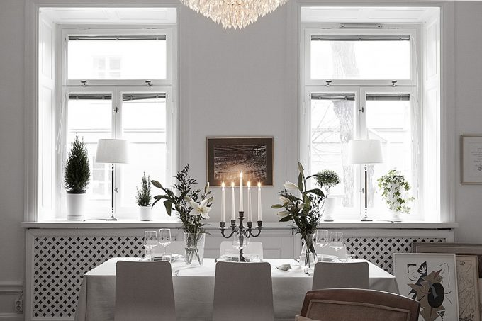 Wonderful Dining Room With Candles And White Interior Decor Also Natural Light From Windows