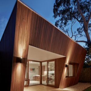 Wooden Deck And Wall Lightings In Wooden House Design Ideas