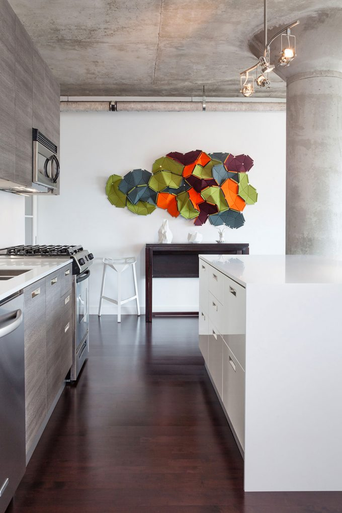 Art Wotk For Wall Decor And Dark Wood Floor Also Glossy White Countertops Cabinets