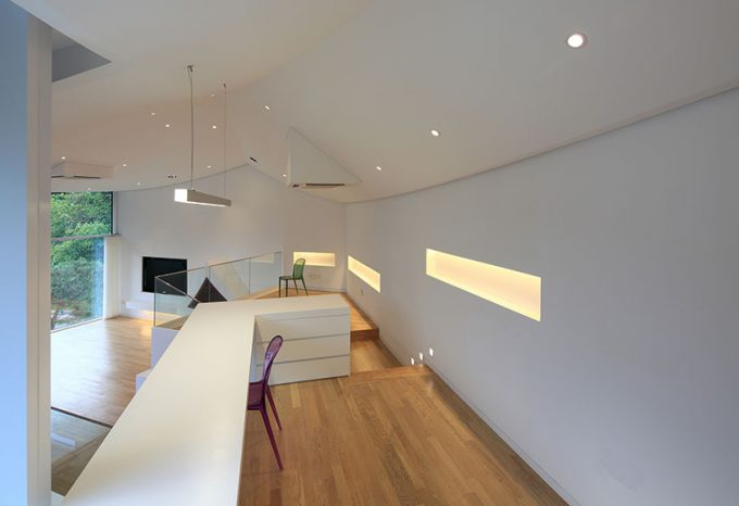 Awesome Interior With Arange Wall Lighting And White Wall Mix With Bright Wood Flooring