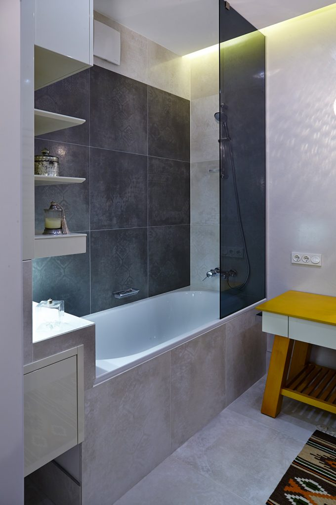 Bathtub With Shelves And Light Brown Ceramic Tiles
