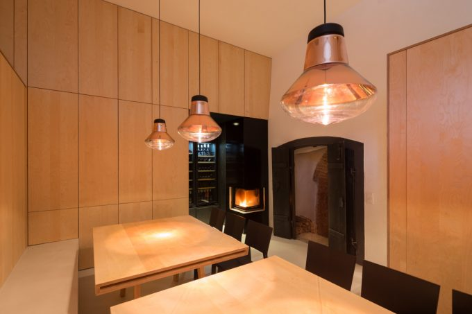 Beautiful Basement Dining Room With Laminated Wood Furnishing And Wine Fridge Also Prefab Fireplace