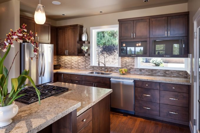 Beautiful Kitchen Design With Oak Wood Cabinetry Also Marble Countertops Plus Orchid Plant As Centerpiece