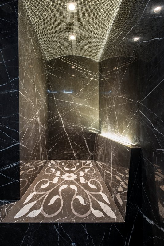 Beautiful Shower Space Design With Black Marble And Patterned Tile Floor Plus Pixeled Ceiling With Ceiling Lighting