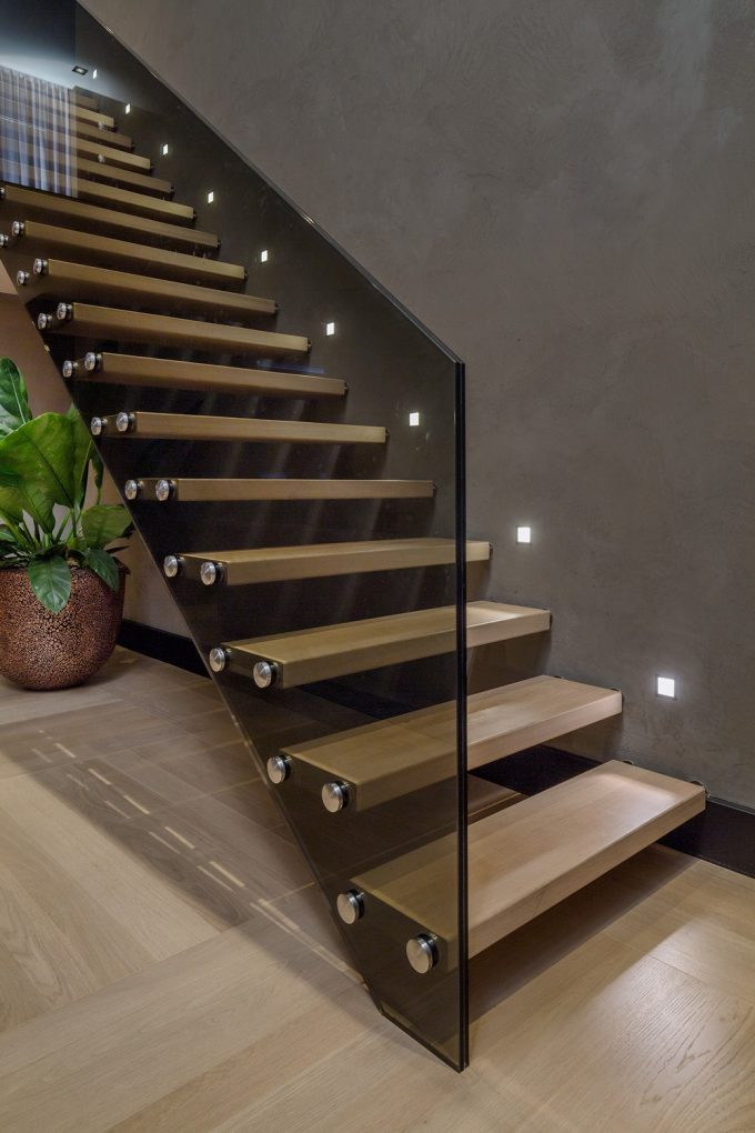 Beautiful Wood Stair With Dark Glass Handrail And Stairs Lighting Also Brown Wall