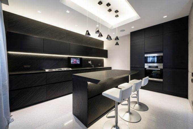 Black Kitchen Cabinets With Black Kitchen Island And White Flooring Also Recessed Ceiling Lighting With Neon Lighting And Pendants Lamp Decor