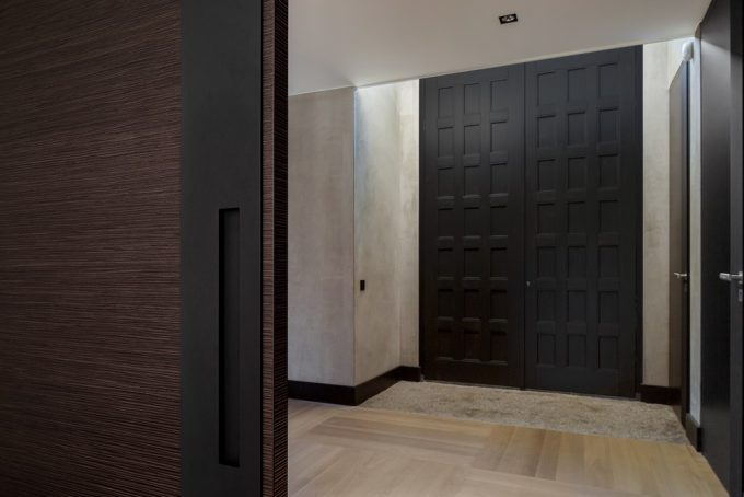 Black Wood Door With Light Brown Carpet Also White Wall Enterence