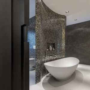 Boat Like White Tub With Pixeled Wall Partition And White Floor Plus Down Lighting