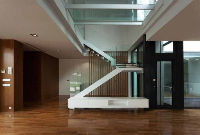 Breezy Interior With Wooden Flooring And Glass Windows Also Modern Staircase Plus Natural Light Exposure