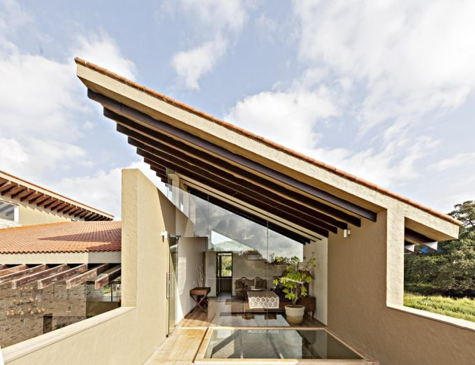Cantilevered Terrace In Monsoon Retreat With Glass Wall And Glass Floor For Luxury Villa Design