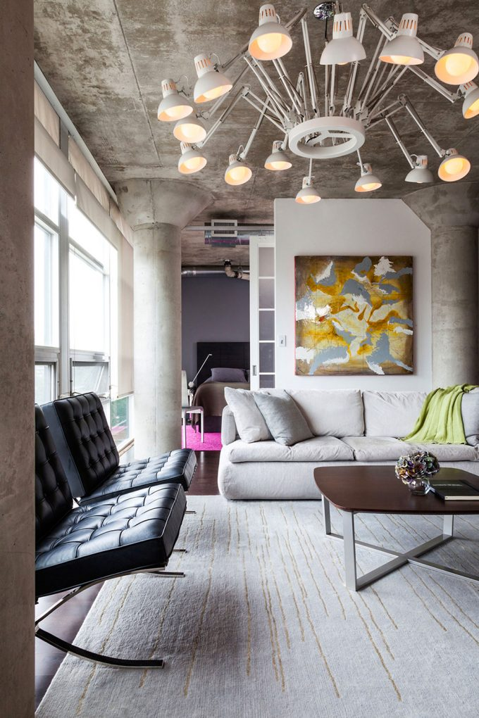 Concrete Ceiling With Artistic Pendants And White Rugs And White Sofa Also Black Ottoman Chairs