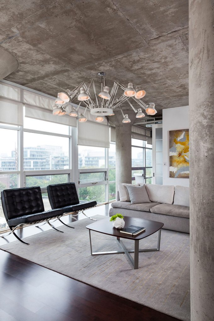 Concrete Pillar And Concrete Ceiling Also Modern Living Room Design With Bright Sun Lighting From Glass Windows With White Blinds