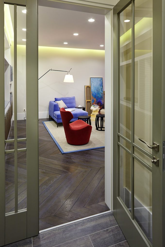 Contemporary Hard Wood Flooring With Green Frame Glass Door