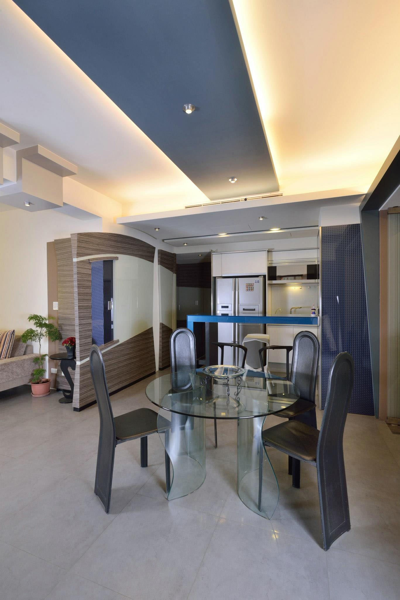Drop Ceiling Decor With Yellow Neon Lighting Over The Kitchen Area And Dining Area