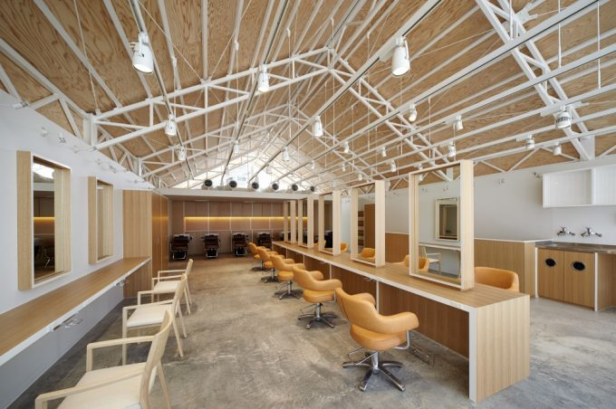 Drop Ceiling Lighting And Steel Structure Roof In Open Plan Hair Salon Interior