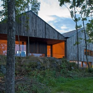Evening View Of Green House Design That Nested In Norway