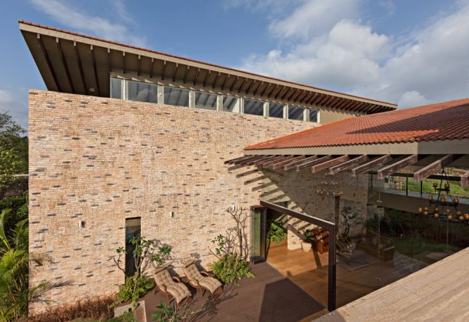 Exterior Cladding Natural Stone Brick With Natural Brown Patio Using Lounge Chairs Perfect House Retreat Design
