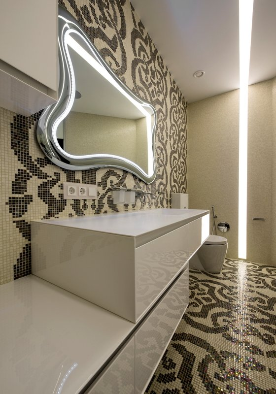 Geometric Bathroom With Pattern Pixeled Tile Wall And Floor Also Custom Mirror With LED Lighting And Futuristic Vanity Unit