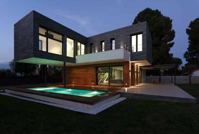 Hanging Building With Awesome Pool Below Completed With Green Pool Lighting