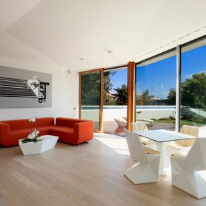 Interesting Neat White Interior With Red Sofa With White Sharp Table Also White Sharp Coffee Table An Chairs