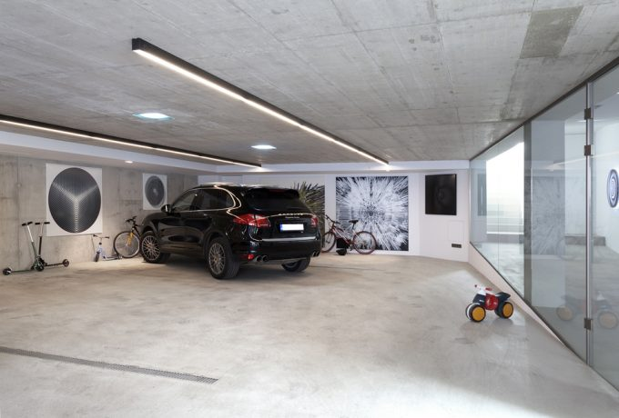 Large Garage With Concrete Wall And Floor Also Ceiling With Glass Doors